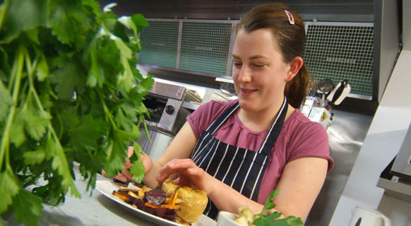 Photograph of one of our happy cooks at Fenton Barns Café